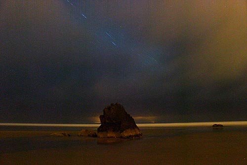 Surreal scene of Cannon Beach at night